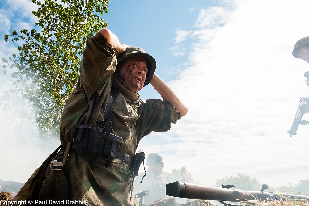 Reenactors portraying a soldier from the Panzer Grenadier Division Großdeutschland takes part in a small scale skirmish during a living history display at Ackworth Steam Rally
