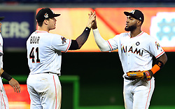 May 31, 2017 - Miami, FL, USA - The Miami Marlins' Justin Bour, left, and Marcell Ozuna celebrate a 10-2 victory against the Philadelphia Phillies on Wednesday, May 31, 2017 at Marlins Park in Little Havana in Miami. (Credit Image: © Pedro Portal/TNS via ZUMA Wire)