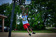 TUNICA, Miss. - May 27 2014: Tarvarious Isabell, 11, plays basketball outside his Tunica home. Isabell has lived in Tunica his whole life. Caesars Entertainment Corp. plans to close Harrah's Tunica casino on June 2. CREDIT William DeShazer for the New York Times