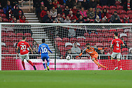 Middlesbrough goalkeeper Dimi Konstantopoulos (1) watches anxiously as the ball flashres across hisd goal mouth as Peterborough United midfielder Siriki Dembélé (10) tries to get a touch during the The FA Cup 3rd round match between Middlesbrough and Peterborough United at the Riverside Stadium, Middlesbrough, England on 5 January 2019.