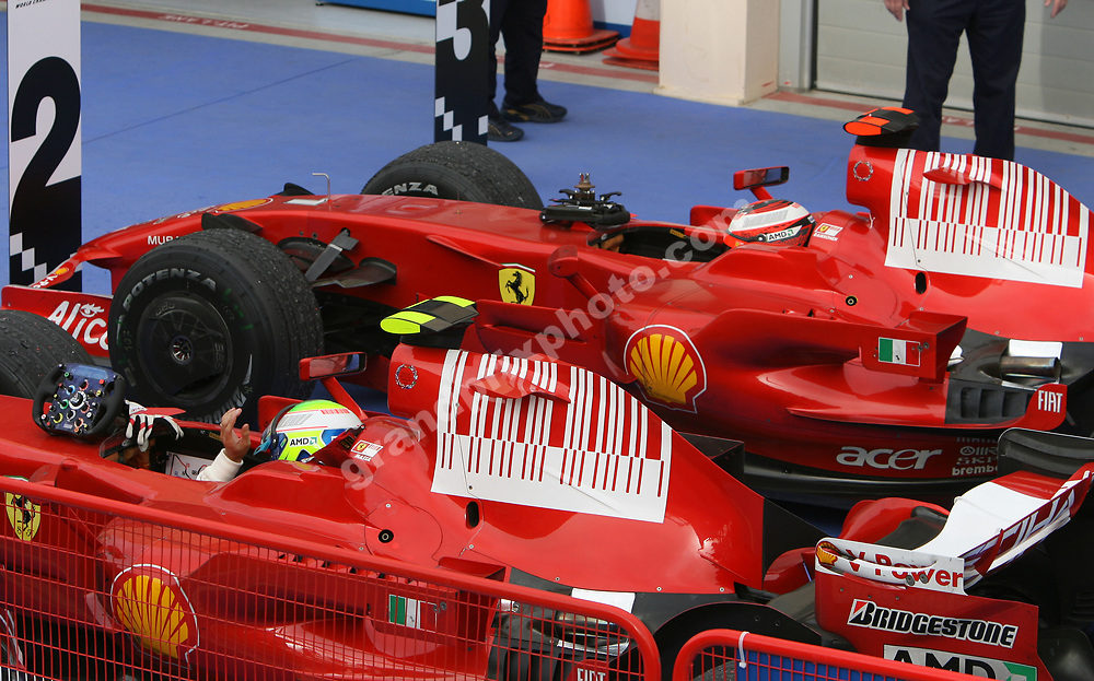 Ferrari drivers Felipe Massa and Kimi Raikkonen in parc ferme after the 2008 Bahrain Grand Prix. Photo: Grand Prix Photo
