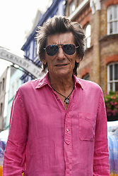 "**CAPTION CORRECTION - Rhino statues are 750mm tall, not 750cm tall, as stated in previous captions**<br /> © Licensed to London News Pictures. 20/08/2018. LONDON, UK. Ronnie Wood stands in Carnaby Street with his painted rhino ""Spike"" during a photocall.  At 750mm tall and weighing 300 kg, each rhino has been specially embellished by an internationally renowned artist.  21 rhinos are in place at a popular location in central London, forming the Tusk Rhino Trail, until World Rhino Day on 22 September to raise awareness of the severe threat of poaching to the species' survival.  They will then be auctioned by Christie's on 9 October to raise funds for the Tusk animal conservation charity.  Photo credit: Stephen Chung/LNP"