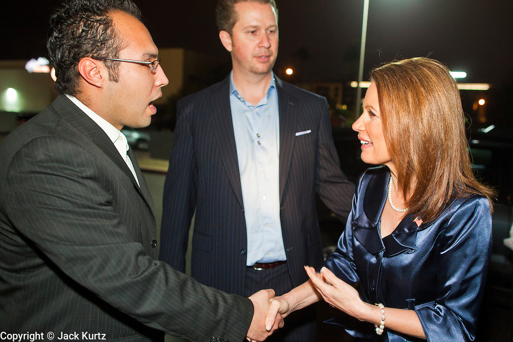 """11 DECEMBER 2011 - SCOTTSDALE, AZ:    Congresswoman and Republican Presidential hopeful MICHELE BACHMANN (right) arrives for a fundraiser sponsored by Politics on the Rocks at the Mint in Scottsdale Sunday. The Mint is a popular bar and restaurant built in a former bank in Scottsdale, AZ. Politics on the Rocks was started by Charles A. Jensen in Scottsdale, Arizona. The purpose of """"Politics on the Rocks"""" is to bring Republican & Conservative Professionals together in a monthly happy hour where they can network, socialize, and hear directly from prominent politicians and successful business leaders.    PHOTO BY JACK KURTZ"""