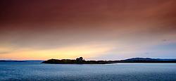 Sunset over Duart Castle, Isle of Mull, Scotland<br /> <br /> (c) Andrew Wilson | Edinburgh Elite media