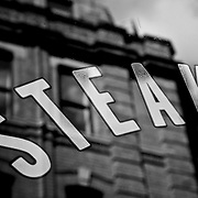 STEAK lettering on window with reflection, London, England (September 2007)