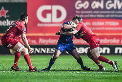 Leinster's Bryan Byrne is tackled by Scarlets' Ryan Elias<br /> <br /> Photographer Craig Thomas/Replay Images<br /> <br /> Guinness PRO14 Round 17 - Scarlets v Leinster - Friday 9th March 2018 - Parc Y Scarlets - Llanelli<br /> <br /> World Copyright © Replay Images . All rights reserved. info@replayimages.co.uk - http://replayimages.co.uk