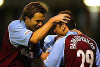 Photo Aidan Ellis.<br />Burnley v Preston North End (Nationwide Div 1).<br />008/045/2003.<br />Burnley's Ian Moore celebrates with Dimi Papadopoulos