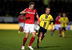 Nottingham Forest's Michael Dawson (left) and Burton Albion's Liam Boyce during the Carabao Cup, Fourth Round match at the Pirelli Stadium, Burton.