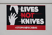 A 'Stop Knife Crime' campaign sticker on the side of a Hertfordshire Police vehicle is pictured on 14 September 2020 in West Hyde, United Kingdom. Lives Not Knives is a youth-led charity that works to prevent knife crime, serious youth violence and school exclusions by engaging, educating and supporting disadvantaged young people.