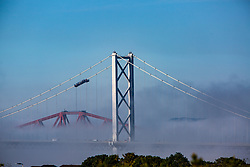 The Queensferry Bridge, The Forth Road Bridge and The Forth Bridge rise in this evenings haar, the coastal fog which typically forms in Spring and Summer over eastern Scotland.