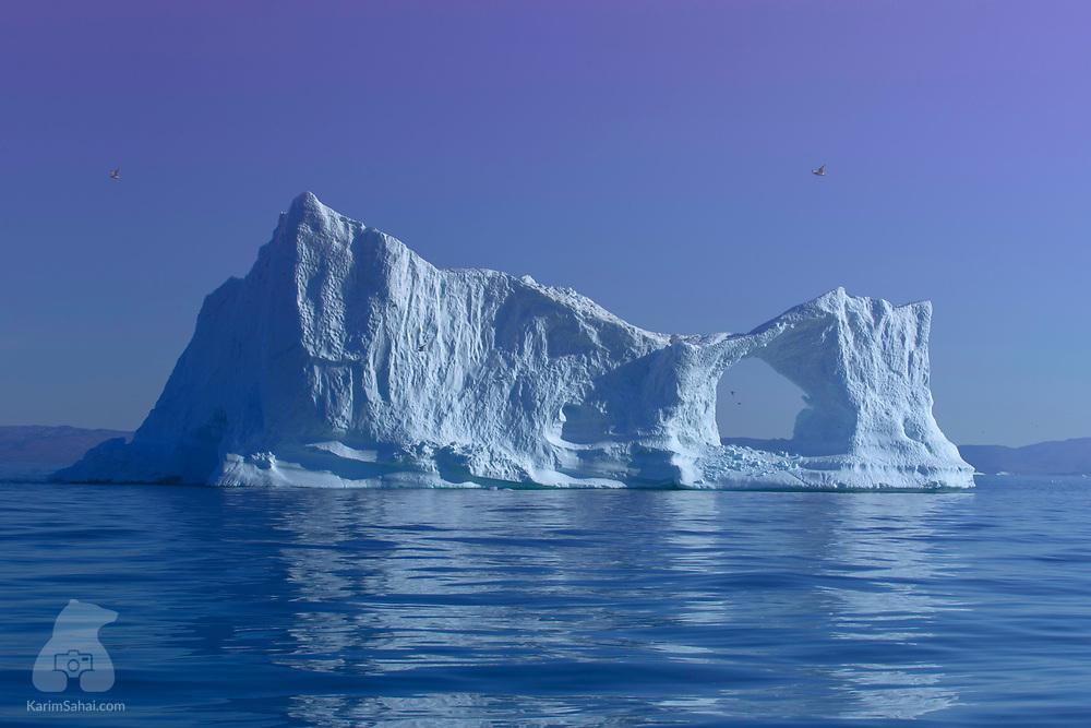 Iceberg with a hole, Disko Bay, Greenland