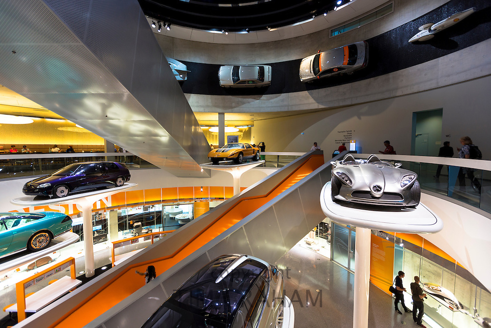 Mercedes-Benz concept cars in their museum gallery in Stuttgart, Bavaria, Germany. Silver is F400 Carving V6 from 2001, orange is C111 from 1970