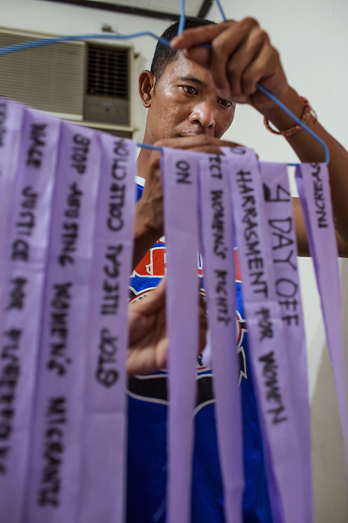Jonald Francisco, a resident at the Serve The People Association Shelter, arranges ribbons made by members of Migranteng Kababaihan Sa Taiwan, a new grassroots Filipino labor group. The group is centered on helping migrant workers in need and offering advice and case support for workers who find themselves in bad positions. Migranteng Kababaihan Sa Taiwan had their opening event Sunday June 28th, 2015 in Kaohsiung, Taiwan.
