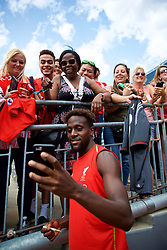 ANN ARBOR, USA - Friday, July 27, 2018: Liverpool's Divock Origi takes a selfie with a supporter's iPhone after a training session ahead of the preseason International Champions Cup match between Manchester United FC and Liverpool FC at the Michigan Stadium. (Pic by David Rawcliffe/Propaganda)