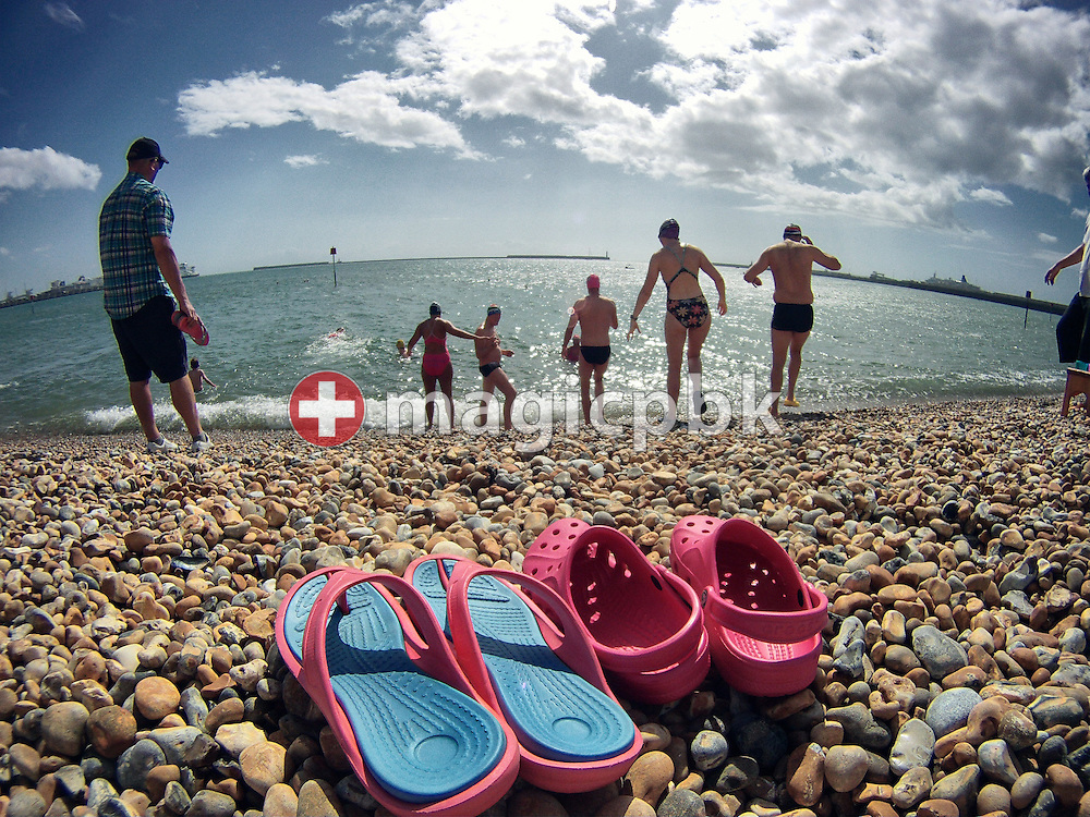 Flip-Flops and Crocs of swimmers left back at the beach during a training session at the harbour in Dover, Great Britain, Sunday, Aug. 18, 2013. Gino Deflorian tries to become the first Swiss male swimmer who successfully swims the English Channel form Dover/Folkestone to Calais, France. (Photo by Patrick B. Kraemer / MAGICPBK)