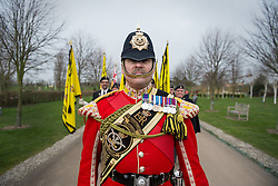 © Licensed to London News Pictures. 27/02/2016. <br /> <br /> Pictured: Warrant Officer Class 2 Greg Hedges, Mascot Handler, leads the march at the Operation Granby Service at The National Memorial Arboretum on Saturday 27th February 2016.<br /> <br /> A service has been held at The National Memorial Arboretum on Saturday 27th February 2016 to commemorate The Stafford Regiments participation in Operation Granby, a British military operation held in 1991 during the first Gulf War in which soldiers helped liberate Kuwait from Iraqi occupation ordered by Saddam Hussain.    <br /> <br /> Two Staffordshire Regiment soldiers, Private Carl Moult and Private Shaun Taylor were killed in Operation Granby.<br /> <br />  Photo credit should read Max Bryan/LNP