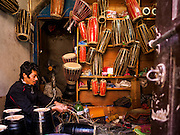 06 MARCH 2017 - KATHMANDU, NEPAL:  A man at work in a small shop that makes and sells drums in Kathmandu.     PHOTO BY JACK KURTZ