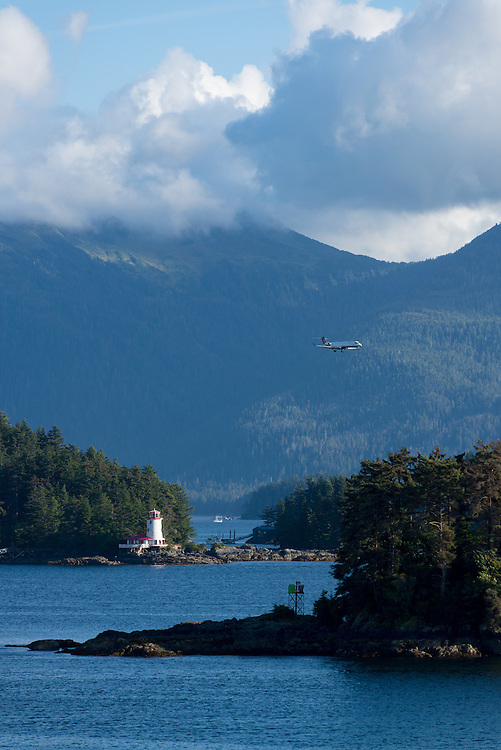 Delta Airlines jet flying over islands and lighthouse on it's approach for landing in Sitka, Alaska.