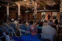 Steve Scarfo entertains the crowd at the Belknap Mill's evening of comedy event hosted by Fusion on Saturday evening.  (Karen Bobotas/for the Laconia Daily Sun)
