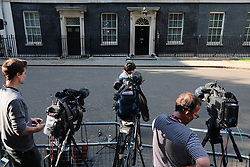 © Licensed to London News Pictures. 22/05/2019. London, UK. TV crews set up opposite the door to 10 Downing Street. Several ministers have requested private meetings with the Prime Minister this evening. Photo credit: Rob Pinney/LNP