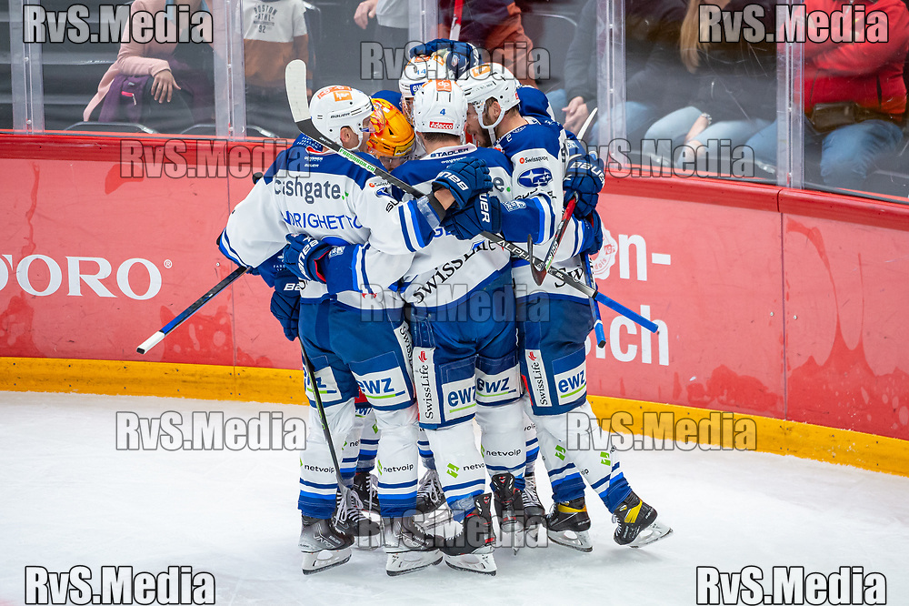 LAUSANNE, SWITZERLAND - OCTOBER 01: Dario Trutmann #86 of ZSC Lions celebrates his goal with teammates during the Swiss National League game between Lausanne HC and ZSC Lions at Vaudoise Arena on October 1, 2021 in Lausanne, Switzerland. (Photo by Robert Hradil/RvS.Media)