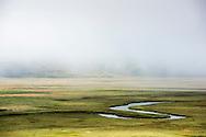 Looking down on Flat Creek in the morning fog in the National Elk Refuge outside Jackson, WY. ©Brett Wilhelm
