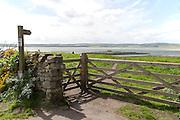 Footpath sign and gateway Holy Island, Lindisfarne, Northumberland, England, UK