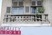 Israel, Jaffa Humour - old dilapidated building with a beauty sign