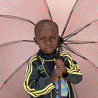 KAYUMBU RWANDA-OCT 11:  A young boy in the Rwandan countryside. Rwanda is the most densely populated country in Africa. There are an estimated 352 people per square kilometer.  35 percent of the population engage in subsistence agriculture and live under the poverty line.  But with a growth rate of 6-8 percent  since 2003 the poverty rate is declining. (Photo by William Campbell-Corbis via Getty Images)