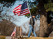 22 NOVEMBER 2019 - DES MOINES, IOWA: Members of the Patriot Guard Riders walk into the reinterment service for Marine Corps Reserve Private Channing Whitaker at the Glendale Cemetery. Whitaker died in the Battle of Tarawa on Nov. 22, 1943 during World War Two. He was buried on Betio Island, in the Gilbert Islands, and his remains were recovered in March 2019. He was identified by a DNA match with surviving family members in Iowa. Whitaker was reintered in the Glendale Cemetery in Des Moines exactly 76 years after his death in World War Two. About 1,000 US Marines and sailers were killed in four days during the Battle of Tarawa.            PHOTO BY JACK KURTZ