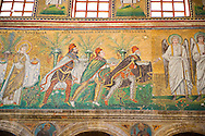 Byzantine Roman mosaics , c. 561 AD, in the Basilica of Sant' Apollinare Nuovo, depicting  the Three Magi, moving from the city of Classe towards the group of the Madonna and Child surrounded by four angels. Ravenna Italy, A UNESCO World Heritage Site.