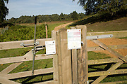 Conservation grazing notice signs on fence, Shottisham, Suffolk Sandlings, England