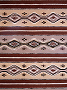 Wide Ruins Navajo Rug woven by Louise Johnson of Crownpoint, New Mexico. Please note that use of this photo requires an extra licensing fee to be paid to rug weaver Louise Johnson.