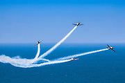 Israeli Air force (IAF) Flight Academy Beechcraft T-6A Texan II aerobatics team during a display over the Mediterranean Sea