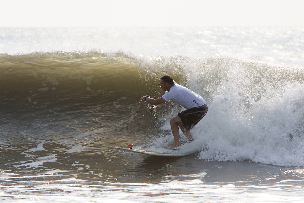 VIRGINIA BEACH, VA - AUGUST 28: Surfers take advantage of waves created by Hurricane Cristobal at the Oceanfront on Thursday, August 28th, 2014 in Virginia Beach, Va. (Photo by Jay Westcott/Zuma Press)