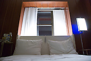 hotel room bed with two cushions