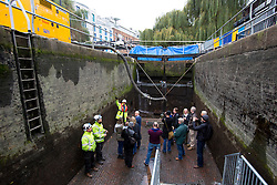 © licensed to London News Pictures. London, UK 17/11/2013. Members of public visiting the bottom of the drained chamber of Camden Lock and the Regent's Canal which was drained for maintenance as part of a £45million countrywide project and £130,000 restoration scheme at Regent's Canal. Engineers are replacing both sets of lock gates, as well as carrying out brickwork repairs, repointing and timberwork. Photo credit: Tolga Akmen/LNP