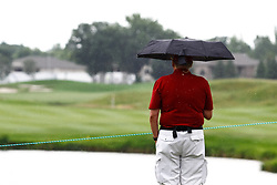 August 3, 2018 - Blaine, MN, U.S. - BLAINE, MN - AUGUST 03: A fan stands with their umbrella as rain starts to fall during the first round of the 3M Championship on August 3, 2018 at TPC Twin Cities in Blaine, Minnesota. (Photo by David Berding/Icon Sportswire) (Credit Image: © David Berding/Icon SMI via ZUMA Press)
