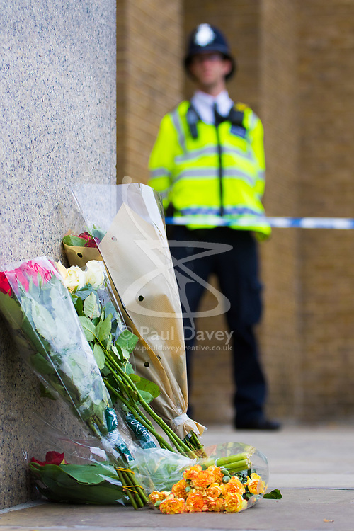 London, June 4th 2017. Flowers from well wishers can be seen all around the police perimeter during a massive policing operation in the aftermath of the terror attack on London Bridge and Borough Market on the night of June 3rd which left seven people dead and dozens injured