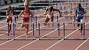 Virginia Powell aka Ginnie Powell of USC (second from right) and Priscilla Lopes of Nebraska (second from left) duel in the women's 100-meter hurdles in the NCAA Track & Field Championships at Sacramento State's Hornet Stadium in Sacramento, Calif. on Friday, June 9, 2006. Powell won in a collegiate record 12.48 and Lopes was second in 12.60. Melaine Walker of Texas (left) was third in 12.75 and Dawn Harper of UCLA was fourth in 12.92.