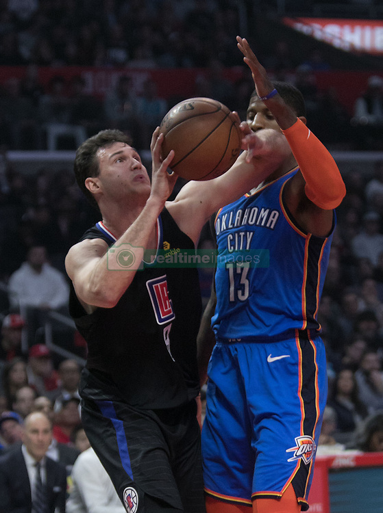 March 8, 2019 - Los Angeles, California, U.S - Danilo Gallinari #8 of the Los Angeles Clippers is fouled by Paul George #13 of the Oklahoma Thunder during their NBA game on Friday March 8, 2019 at the Staples Center in Los Angeles, California. JAVIER ROJAS/PI (Credit Image: © Prensa Internacional via ZUMA Wire)