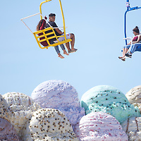 Beach goers ride above a giant sculpture of ice cream on the roof of a boardwalk restaurant in Seaside Heights, NJ.
