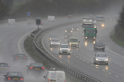 © Licensed to London News Pictures. 5/02/2014<br /> Wet and windy weather conditions continue across the UK. <br /> Drivers on the M25 this afternoon (5.02.2014) having to deal with heavy rain and strong winds at the Swanley Junction 3, Kent.<br /> Photo credit :Grant Falvey/LNP