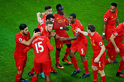 LIVERPOOL, ENGLAND - Monday, December 19, 2016: Liverpool's Sadio Mane celebrates scoring a late injury-time winning goal against Everton, to seal a 1-0 victory, with team-mates during the FA Premier League match against Liverpool, the 227th Merseyside Derby, at Goodison Park. (Pic by Gavin Trafford/Propaganda)