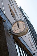 The clock outside the Ace Hotel, Shoreditch, London. The Ace hotel is a boutique hotel in the centre of the gentrified are of Shireditch