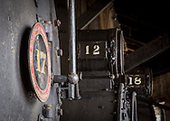 In the roundhouse, three steam locomotives await the call.