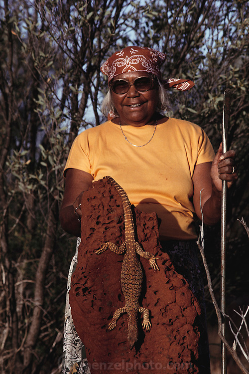Bessie Liddle proudly displaying a goanna lizard that she has just killed. Bessie later cooked the lizard in the hot sand ashes of a campfire: it tasted like tender pork tenderloin. The goanna ('go-anna') is an Australian reptile that is also known as the monitor lizard. Image from the book project Man Eating Bugs: The Art and Science of Eating Insects.