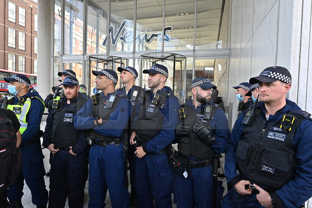 © Licensed to London News Pictures. 16/09/2021. London, UK. Police officers outside The News Building as anti Lockdown and anti Covid vaccination protesters take part in a demonstration calling for an end to mandatory vaccination passports and the vaccination of teenagers. Photo credit: London News Pictures