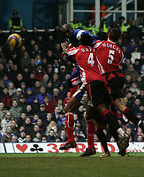 Photo: Lee Earle.<br /> Portsmouth v Sheffield United. The Barclays Premiership. 23/12/2006. Portsmouth's Sol Campbell (L) heads home their second.