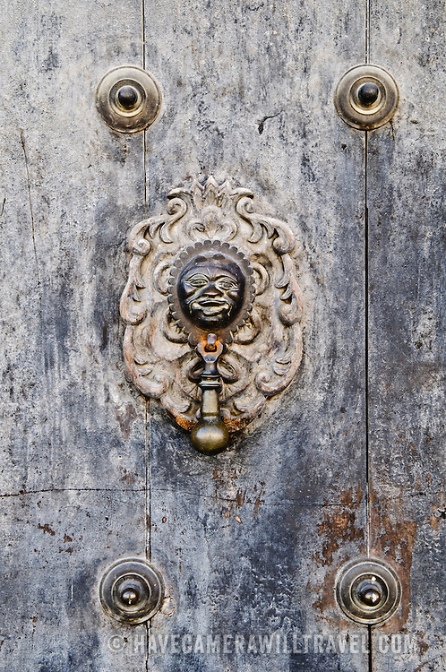 Old wooden doorknocker in Antigua Guatemala. Famous for its well-preserved Spanish baroque architecture as well as a number of ruins from earthquakes, Antigua Guatemala is a UNESCO World Heritage Site and former capital of Guatemala.